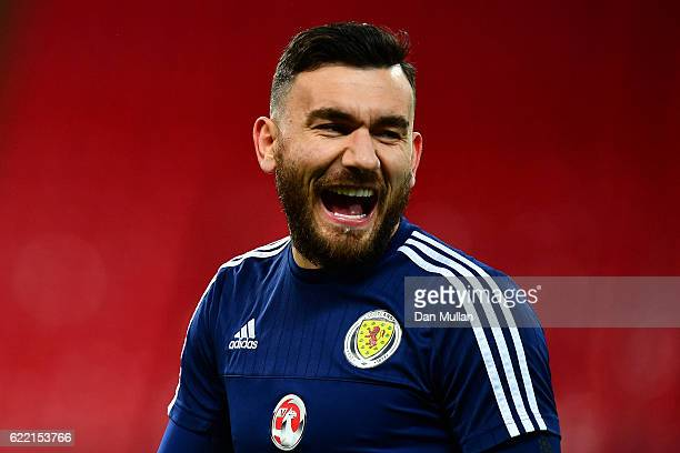 Robert Snodgrass of Scotland laughs during a training session ahead of the FIFA 2018 World Cup qualifying group F match against England at Wembley...