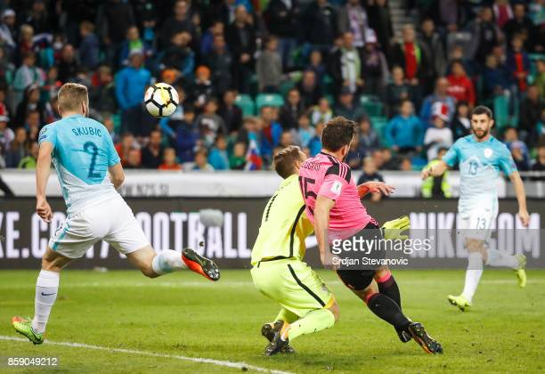 Robert Snodgrass of Scotland scores a goal past goalkeeper Jan Oblak of Slovenia during the FIFA 2018 World Cup Qualifier match between Slovenia and...