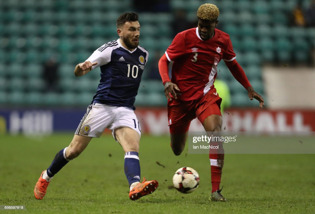 Robert Snodgrass of Scotland vies with Manjrekar James of Canada during the International Challenge Match between Scotland and Canada at Easter Road on March 22, 2017 in Edinburgh, Scotland.