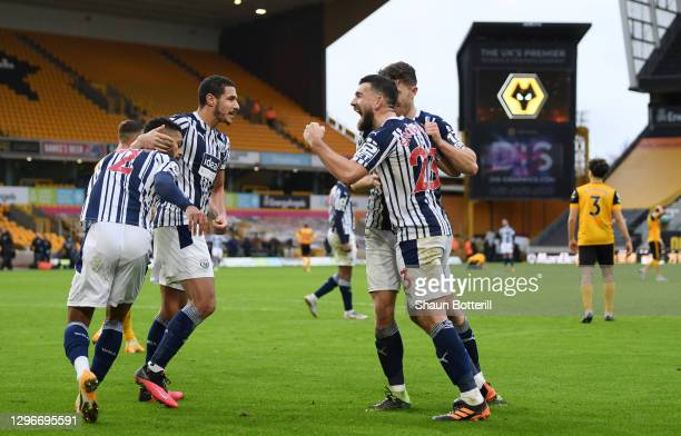 Robert Snodgrass of West Bromwich Albion celebrates with team mates following their side's victory after the Premier League match between...