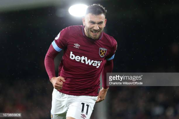 Robert Snodgrass of West Ham celebrates scoring the opening goal during the Premier League match between Fulham FC and West Ham United at Craven...