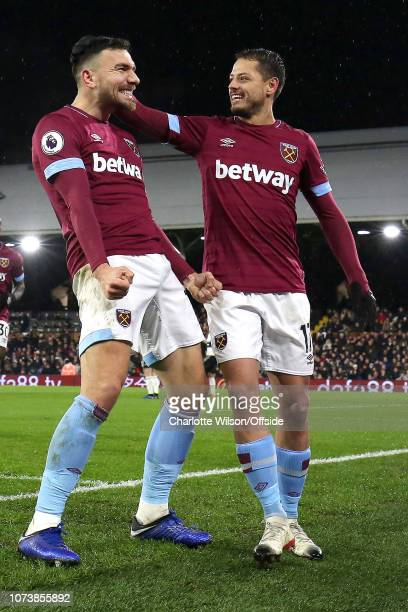 Robert Snodgrass of West Ham celebrates scoring the opening goal with Javier Hernandez during the Premier League match between Fulham FC and West Ham...