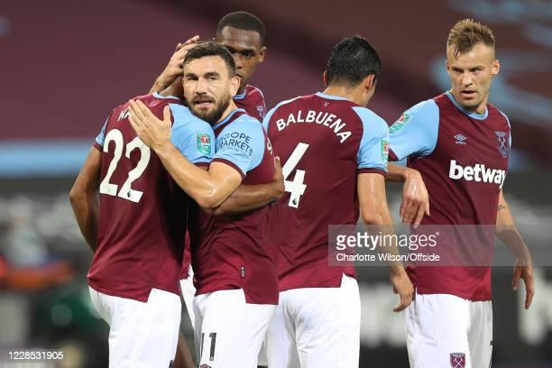 Robert Snodgrass of West Ham celebrates their 2nd goal by hugging goalscorer Sebastien Haller during the match between West Ham United and Charlton...