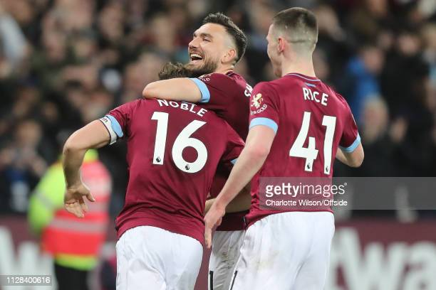 Robert Snodgrass of West ham congratulates Mark Noble on scoring their 2nd goal during the Premier League match between West Ham United and Newcastle...