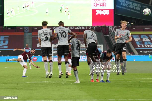 Robert Snodgrass of West Ham sends a freekick through a gap in the defensive wall during the match between West Ham United and Charlton Athletic at...