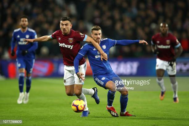 Robert Snodgrass of West Ham United and Joe Bennett of Cardiff City battle for the ball during the Premier League match between West Ham United and...