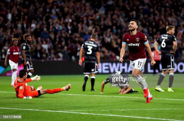Robert Snodgrass of West Ham United celebrates after he scores his sides sixth goal during the Carabao Cup Third Round match between West Ham United...