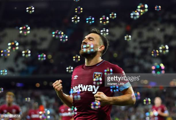 Robert Snodgrass of West Ham United celebrates after he scores his sides second goal during the Carabao Cup Third Round match between West Ham United...