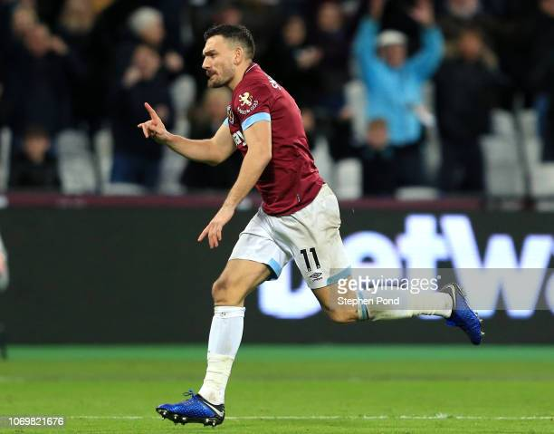 Robert Snodgrass of West Ham United celebrates after scoring his team's first goal during the Premier League match between West Ham United and...