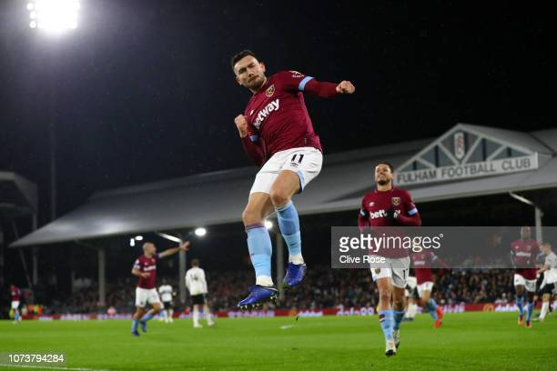 Robert Snodgrass of West Ham United celebrates after scoring his team's first goal during the Premier League match between Fulham FC and West Ham...