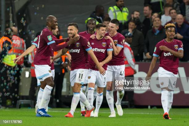 Robert Snodgrass of West Ham United celebrates scoring his side's second goal with teammates during the Carabao Cup Third Round match between West...
