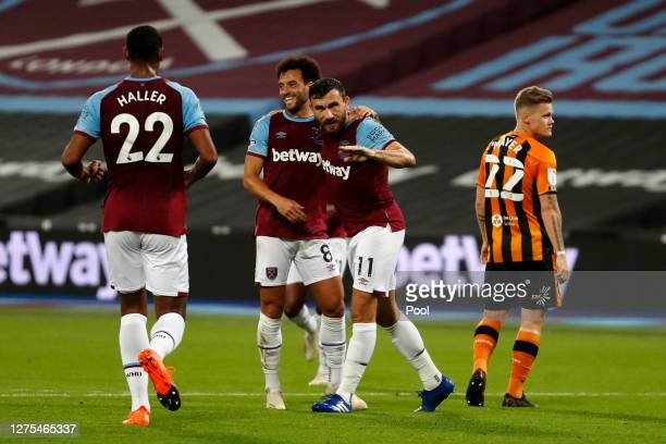 Robert Snodgrass of West Ham United celebrates with Felipe Anderson after scoring his team's first goal during the Carabao Cup Third Round match...