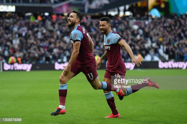 Robert Snodgrass of West Ham United celebrates with Ryan Fredericks after scoring his team's second goal during the Premier League match between West...
