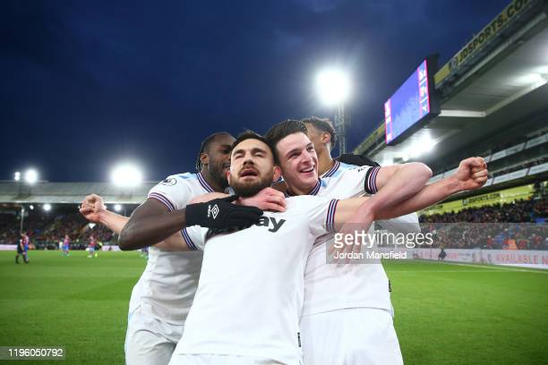Robert Snodgrass of West Ham United celebrates with teammates after scoring his sides first goal during the Premier League match between Crystal...