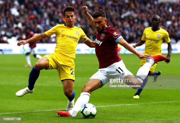 Robert Snodgrass of West Ham United crosses the ball under pressure from Cesar Azpilicueta of Chelsea during the Premier League match between West...