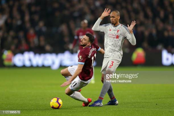 Robert Snodgrass of West Ham United is tackled by Fabinho of Liverpool during the Premier League match between West Ham United and Liverpool FC at...
