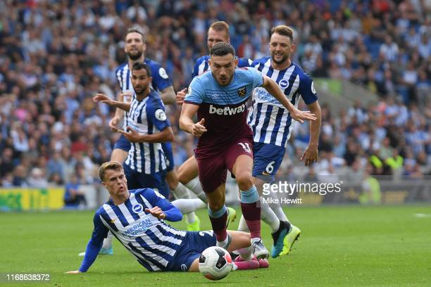 Robert Snodgrass of West Ham United takes on the Brighton defense during the Premier League match between Brighton Hove Albion and West Ham United at...