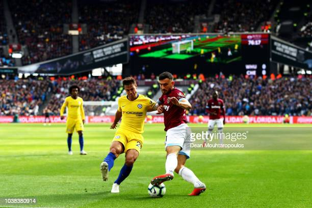 Robert Snodgrass of West Ham United turns with the ball under pressure from Cesar Azpilicueta of Chelsea during the Premier League match between West...