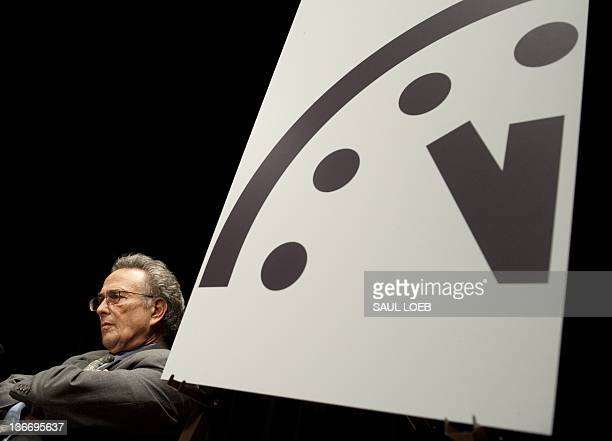 Robert Socolow a professor at Princeton University sits alongside the Doomsday Clock during an announcement by the Bulletin of Atomic Scientists...