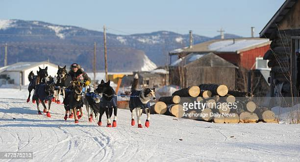 Robert Sorlie drives his team out of the Yukon River village of Kaltag Ak during the 2014 Iditarod Trail Sled Dog Race on Saturday March 8 2014