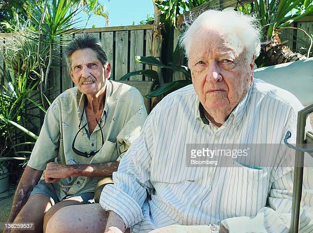 Robert Spain Jr left and his father Robert Spain Sr sit for a photograph outside their home in Jupiter Florida US on Wednesday Dec 21 2011 The...