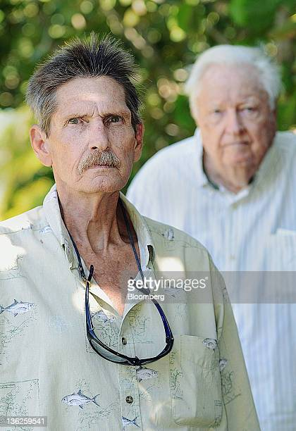 Robert Spain Jr left and his father Robert Spain Sr stand for a photograph outside their home in Jupiter Florida US on Wednesday Dec 21 2011 The...