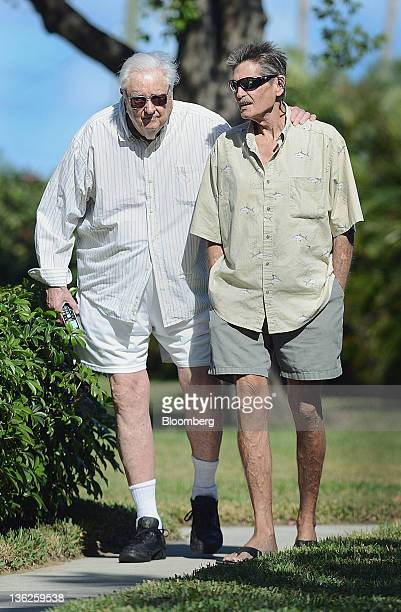 Robert Spain Sr left and his son Robert Spain Jr walk outside their home in Jupiter Florida US on Wednesday Dec 21 2011 The younger Spain was...