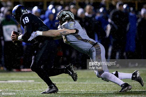 Robert Spillane of the Western Michigan Broncos sacks Grant Rohach of the Buffalo Bulls in the third quarter at Waldo Stadium on November 19, 2016 in...