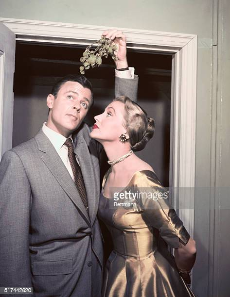 Robert Sterling solicits a little Yuletide attention from his wife Anne Jeffreys with a sprig of Mistletoe Bob and Anne play George and Marion Kerby...