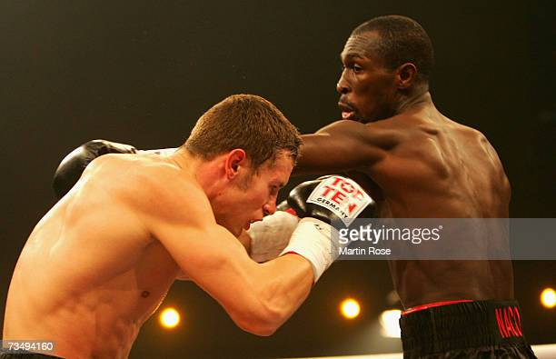Robert Stieglitz of Germany and Alejandro Berrio of Columbia in action during boxing night at the Stadthalle on March 3 2007 in Rostock Germany