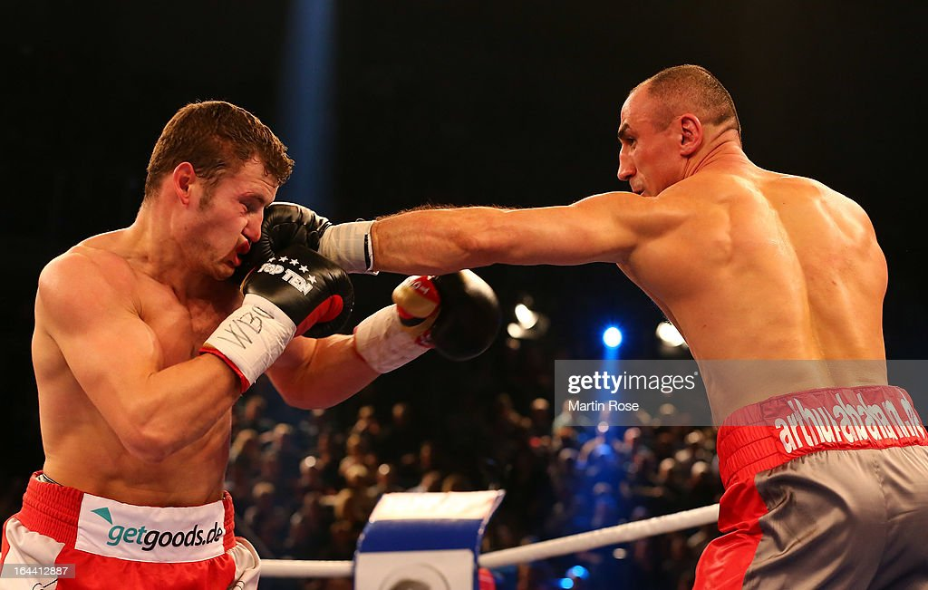 Robert Stieglitz (L) of Germany and Arthur Abraham (R) of Germany exchange punches during the WBO World Championship Super Middleweight title fight at Getec Arena on March 23, 2013 in Magdeburg, Germany.