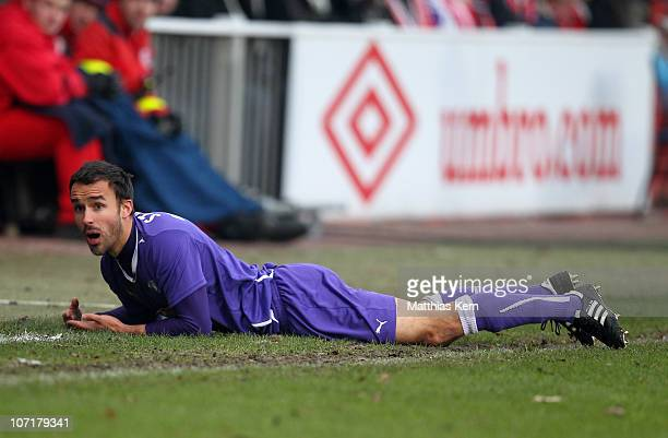 Robert Strauss of Aue lies on the pitch during the Second Bundesliga match between FC Energie Cottbus and Erzgebirge Aue at Stadion der Freundschaft...
