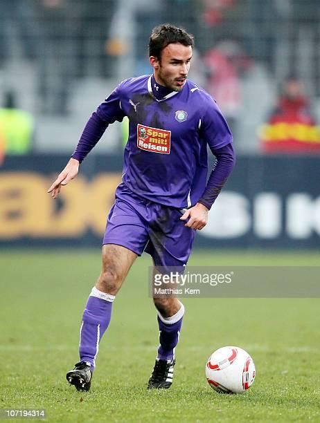 Robert Strauss of Aue runs with the ball during the Second Bundesliga match between FC Energie Cottbus and Erzgebirge Aue at Stadion der Freundschaft...