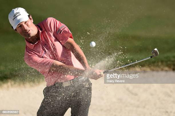 Robert Streb hits his third shot from a greenside bunker on the 18th hole during the first round of the Shell Houston Open at the Golf Club of...