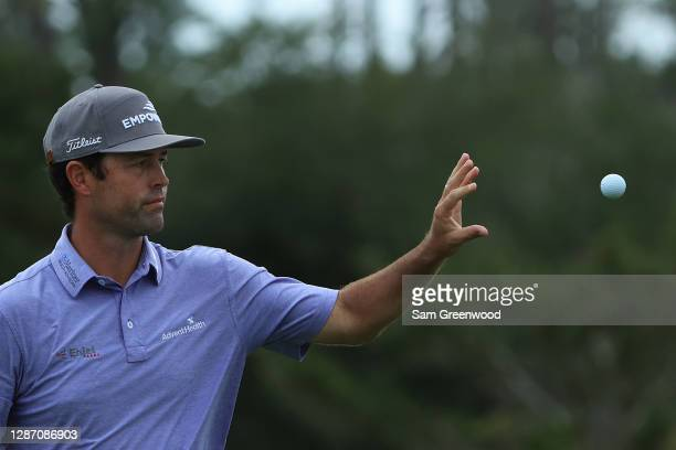 Robert Streb of the United States catches a golf ball on the 13th green during the final round of The RSM Classic at the Seaside Course at Sea Island...
