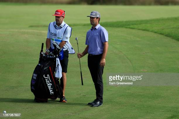 Robert Streb of the United States waits with his caddie during the final round of The RSM Classic at the Seaside Course at Sea Island Golf Club on...