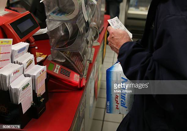 Robert Sweeney walks away with his newly bought Powerball ticket at the BP gas station January 6 2015 in Dunkirk Maryland People are visitingÊlottery...
