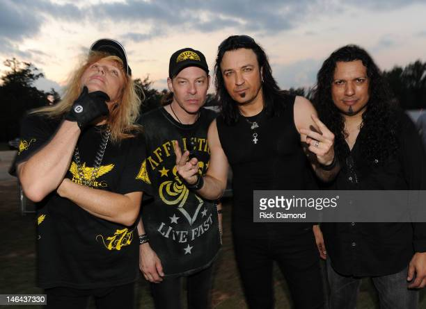 Robert Sweet Tim Gaines Robert Sweet and Oz Fox of Stryper backstage at the 2012 BamaJam Music and Arts Festival Day 2 on BamaJam Farms in Enterprise...