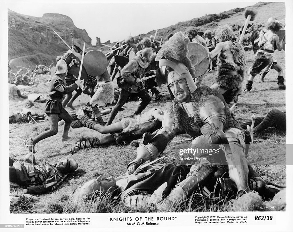Robert Taylor Kneeling Before Fallen Fighter In A Scene From The Film Knights Of