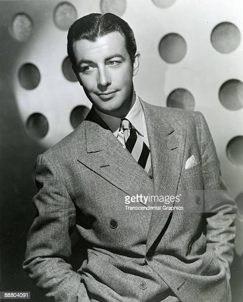 Robert Taylor poses for a portrait during a publicity shoot in Hollywood around 1930