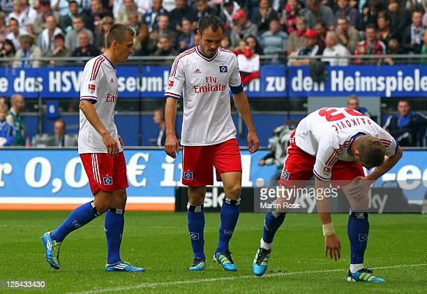 Robert Tesche Heiko Westermann and Slobodan Rajkovic of Hamburg look dejected during the Bundesliga match between Hamburger SV and Borussia...