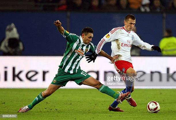 Robert Tesche of Hamburg and Veli Kavlak of Wien compete for the ball during the UEFA Europa League Group C match between Hamburger SV and SK Rapid...