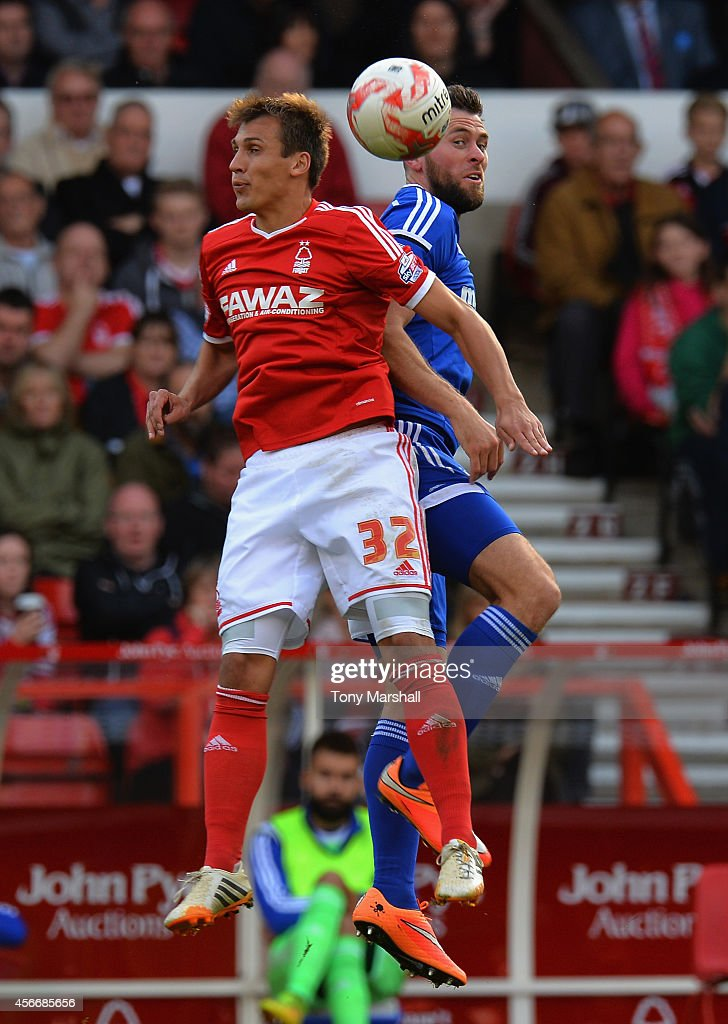 Robert Tesche of Nottingham Forest is tackled by Daryl Murphy of Ipswich Town during the Sky Bet Championship match between Nottingham Forest and Ipswich Town at City Ground on October 5, 2014 in Nottingham, England.