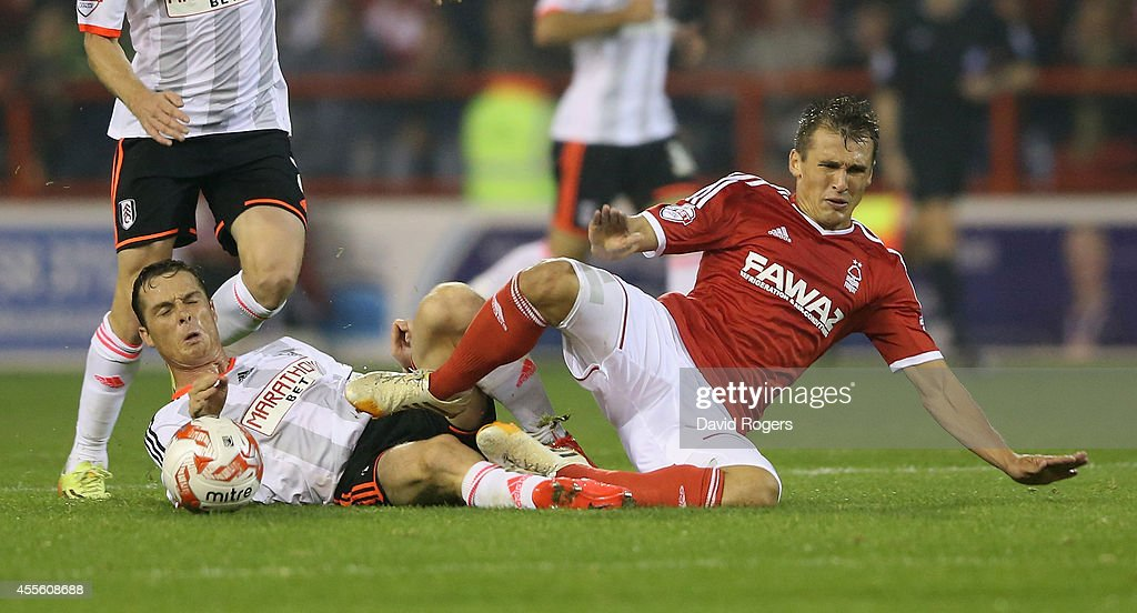 Robert Tesche of Nottingham Forest is tackled by Scott Parker during the Sky Bet Championship match between Nottingham Forest and Fulham at the City Ground on September 17, 2014 in Nottingham, England.