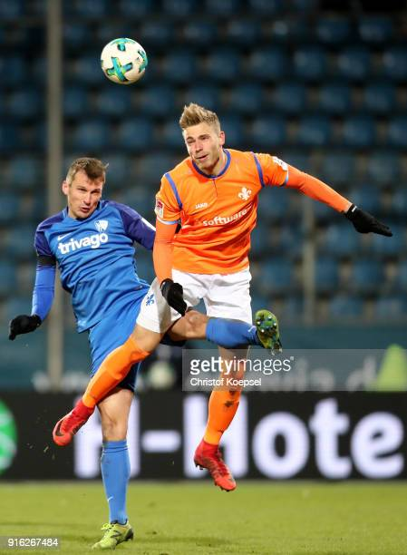 Robert Tesxche of Bochum and Felix Platte of Darmstadt go up for a header during the Second Bundesliga match between VfL Bochum 1848 and SV Darmstadt...