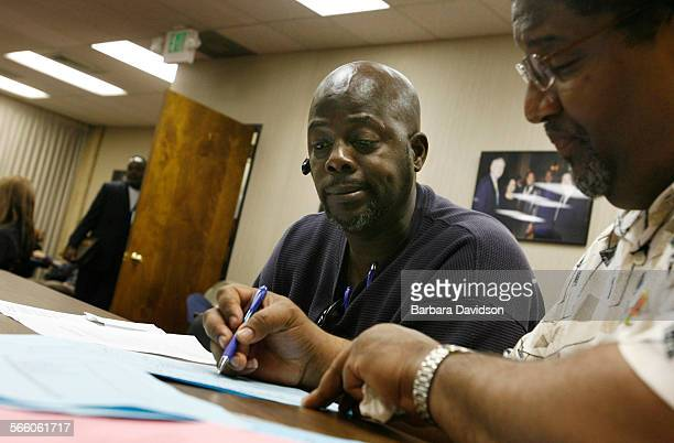 Robert Thingpen a 48–year–old trucker driver who lives in LA works with mortgage councilor Larry S Reed during a foreclosure prevention fair March 3...