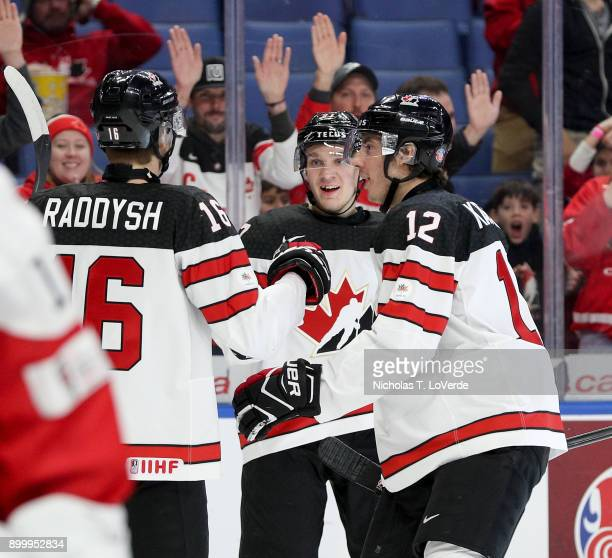 Robert Thomas of Canada celebrates the games opening goal with Taylor Raddysh and Boris Katchouk during the first period of play in the IIHF World...