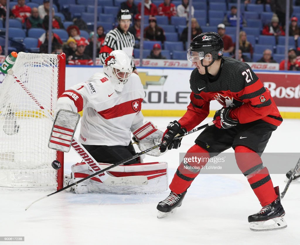 Robert Thomas #27 of Canada skates after a rebound off the pad of Matteo Ritz #1 of Switzerland during the third period of play in the Quarterfinal IIHF World Junior Championship game at the KeyBank Center on January 2, 2018 in Buffalo, New York.