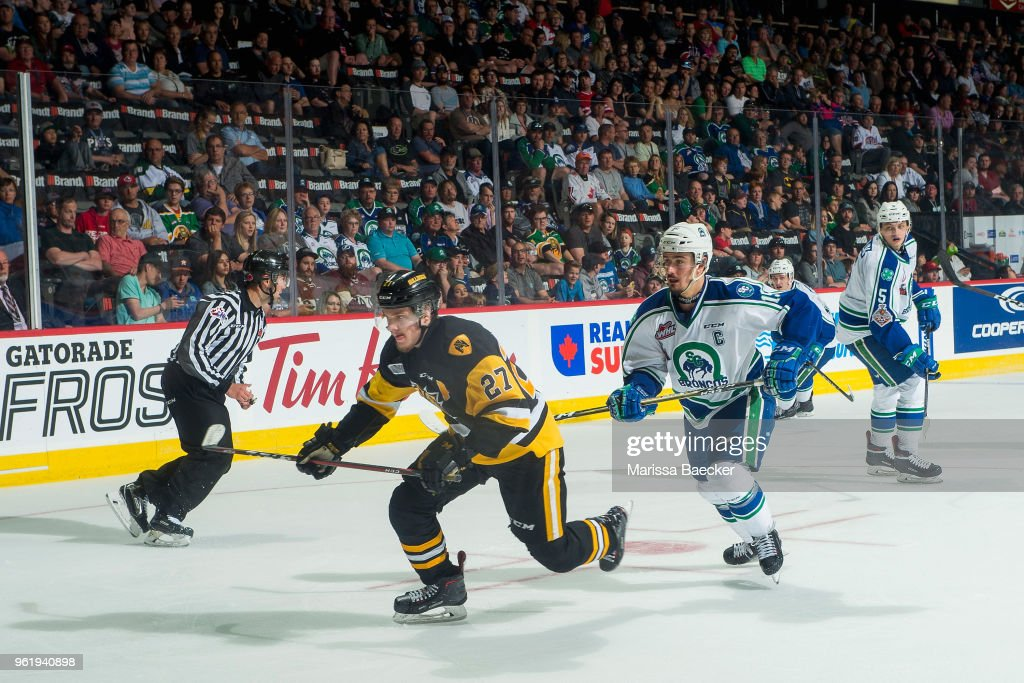 Robert Thomas #27 of Hamilton Bulldogs is back checked by Glenn Gawdin #15 of Swift Current Broncos at Brandt Centre - Evraz Place on May 21, 2018 in Regina, Canada.