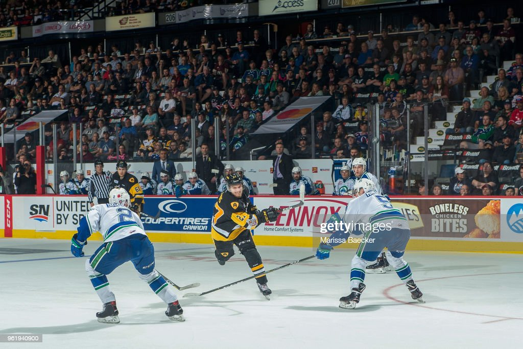 Robert Thomas #27 of Hamilton Bulldogs takes a slap shot between Colby Sissons #2 and Artyom Minulin #5 of Swift Current Broncos at Brandt Centre - Evraz Place on May 21, 2018 in Regina, Canada.